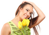 happy woman with yellow tulips over white background.
