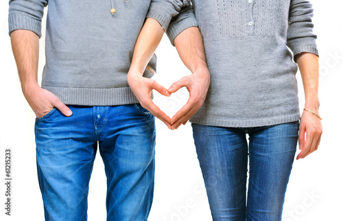 Valentine couple in love showing heart with their fingers
