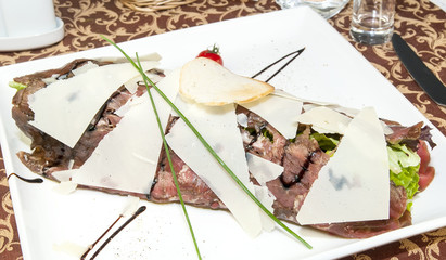 carpaccio on a table in a restaurant