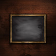 Grunge wood wall background with chalkboard