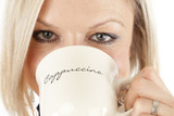 Beautiful Woman is drinking Coffee