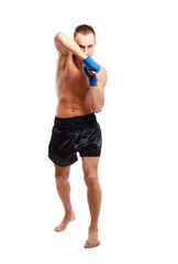 Young handsome boxer man isolated on white background.