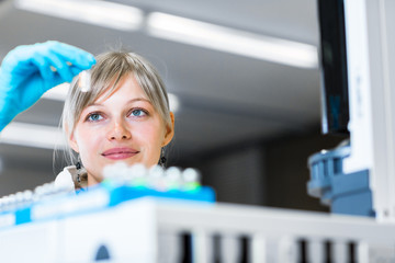 Portrait of a female researcher carrying out research in a lab