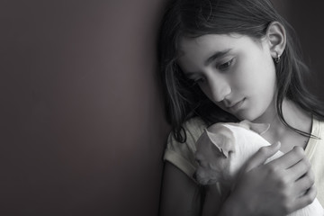 Sad and lonely girl and her small dog