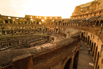inside of Rome's colosseum at sunset