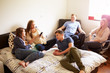 Group Of Teenagers Relaxing In Bedroom