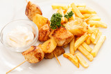 Chicken skewers with french fries