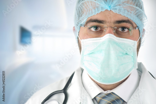 male surgeon gazing and looking at camera at hospital