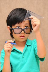 Asian schoolboy learning geometry