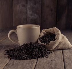 Cup of black tea on a wooden table