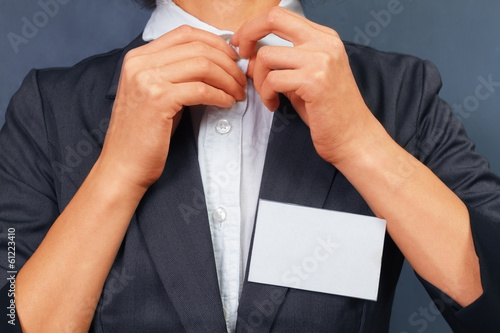 Woman with blank badge, copyspace