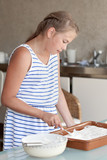 Girl makes cake in kitchen
