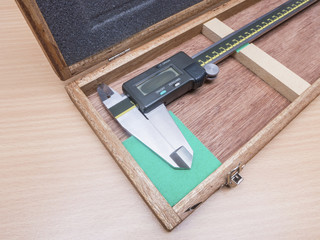 Metal vernier caliper in wooden box package