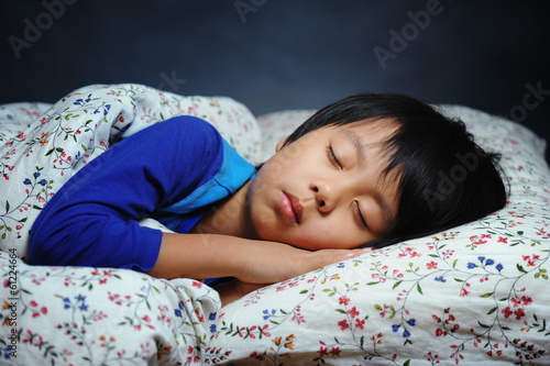 Handsome boy sleeping peacefully - 61224664