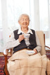 90 year old lady laughing with tea