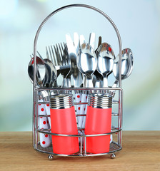 Kitchen cutlery in metal stand