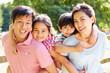 Portrait Of Asian Family Enjoying Walk In Summer Countryside - 61226055