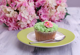 Tasty cupcake with butter cream,