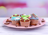 Tasty cupcakes with butter cream,