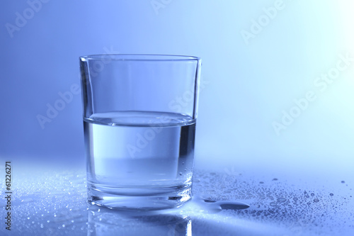 Water in  glass, on dark blue background