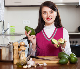 smiling woman with avocado