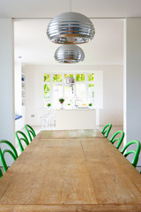 Dining Room In Modern House With Table And Chairs