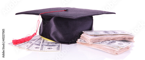 Graduation hat and money isolated on white