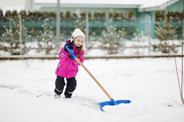 A girl takes pride in completing a shoveling job