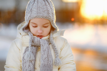 Toddler girl having fun on winter day