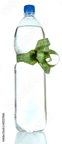 Bottle of water with measuring tape, isolated on white