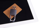 Credit card with lock and tablet close up