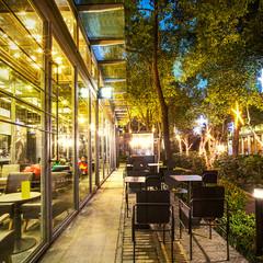 Illuminated restaurant with long footpath