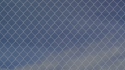wire fence against cloudy sky timelapse