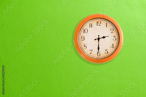 Leinwanddruck Bild Clock showing 02:30 on a green wall