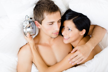 Close up of couple lying in bed-room