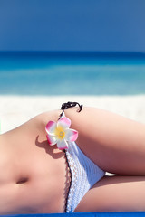 Woman's body is lying on the beach