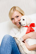 Woman embracing white puppy of Labrador