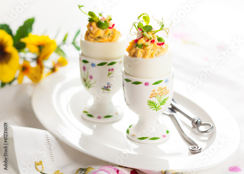 Stuffed eggs in egg cups