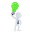 Business man with green light bulb. Concept of business idea