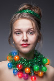 Portrait of the young girl who have put on instead of a beads a
