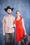 Young american couple with a suitcase