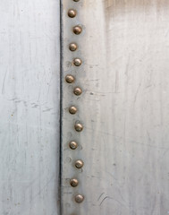 Aluminum background with rivets.