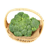 Green broccoli in a wicker basket isolated