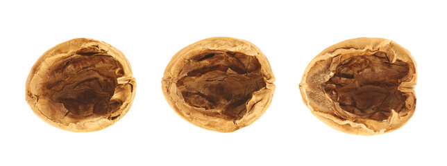 Three walnut shells isolated