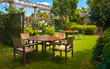 Dining Table set in Lush Landscaped Garden - 61238630