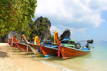 Long tail boat on tropical beach, Krabi, Thailand