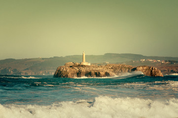 Lighthouse in the big waves, storm in Mouro, Santander, Spain
