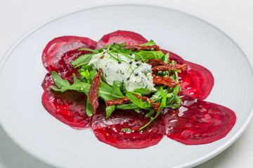 Soft cheese with sliced beetroot salad