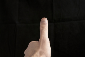 man giving a thumbs up sign