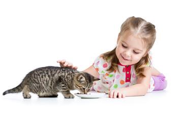 cute kid girl feeding kitten